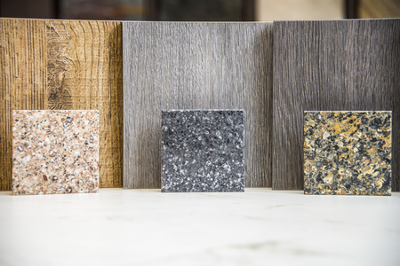 Stone kitchen counter color samples againest kitchen wood door samples