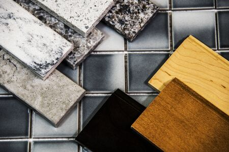 Kitchen counters and kitchen cabinet colors samples over floor tiles Stock Photo