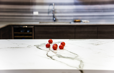 renovated: kitchen island made of marble counter, marble countertop, kitchen surface textured of the marble stone