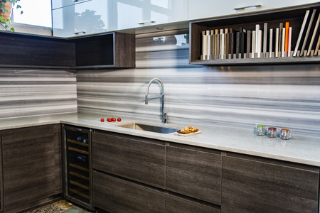 Kitchen Design with Granite Counter, Full Backsplash, Stainless Steel Sink and Faucet, Flat Cabinets Doors, Open Shelves and White Wall Cabints Stok Fotoğraf