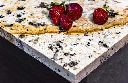 Granite table top (as kitchen island) on blur kitchen background floor - can be used for display or montage your products