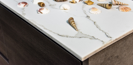 countertops: Shells on marble counter in modern brown kitchen. Marble kitchen  countertop made of natural stone slab Stock Photo