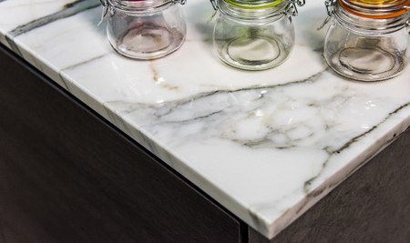 contemporary kitchen: Contemporary kitchen with colorful containers on counter top. Marble kitchen countertop
