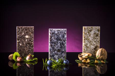 Set of elegant stone samples for kitchen countertop, granite, marble and quartz