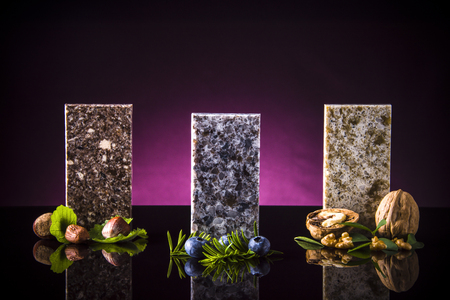 Set of elegant stone samples for kitchen countertop, granite, marble and quartz