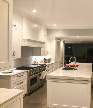 White modern kitchen cabinets with modern appliences and granite countertop
