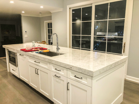 white kitchen island cabinets with white marble countertops
