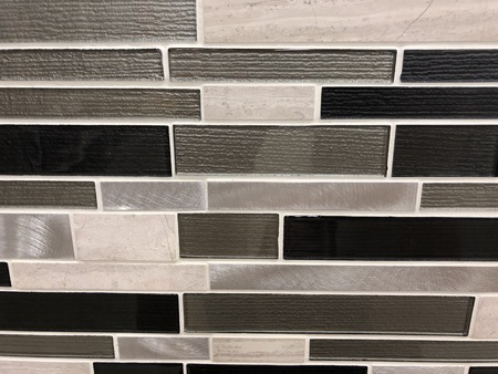 Black and grey rectangular mosaik tiles plased horisontal in stretcher bond,can be used as wall tilesand can be used as kitchen countertop backsplash