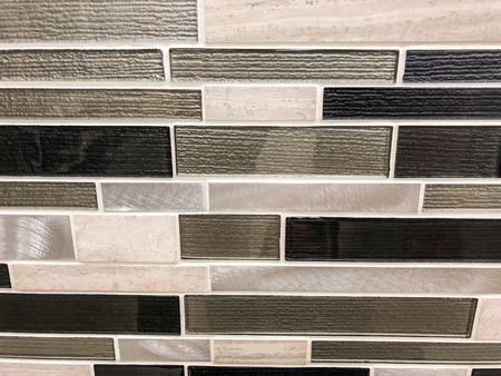 Grey black and beige rectangular mosaic tile,different sises and texture, can be used as bathroom wall and floor tile and can be used as kitchen countertop backsplash Stock Photo