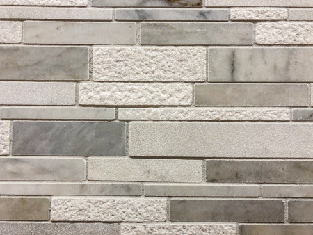 Gray and white tiles of different sises and texture plased horizontal, can be used as wall tile and can be used as kitchen countertop backsplash tile