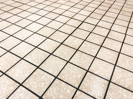 Beige square tiles plased straight with black grid like grout line, can be used as floor and wall tile, and can be used as kitchen countertop backsplash