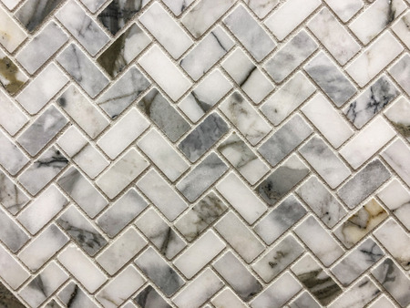 Small gray white and black retangolar tiles aranged in herringbone pattern,can be used as wall and floor tile or as kitchen countertop backsplash tile
