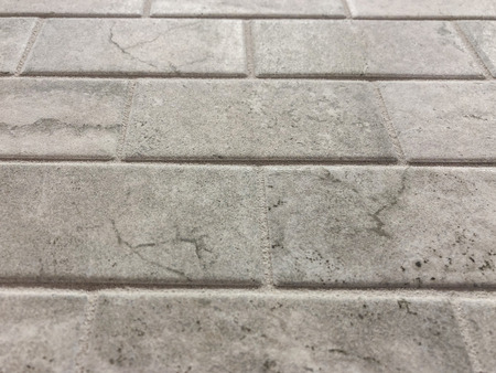 Gray tiles horizontaly layed in stretcher bond,can be used as floor tiles or kitchen countertop becksplash
