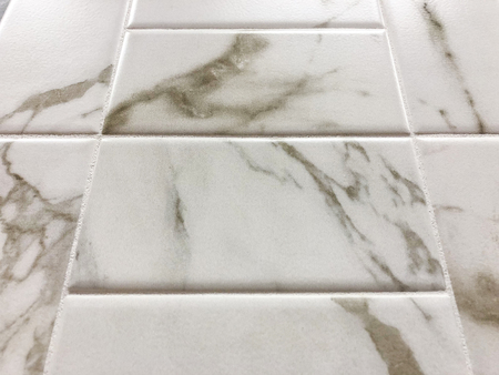 White marble tiles can be used as a wall or floor tiles, or can be used as a kitchen countertop backsplash Stock Photo