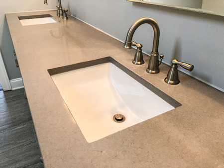 Silestone bathroom countertop with two white sinks and chrome faucets