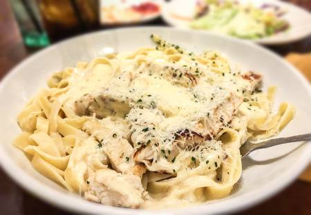 Chicken Alfredo Pasta with Cheese. Selected focus. Pasta made in Italian restaurant called Alfredo.