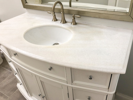 Traditional white marble with wood white cabinet or vanity with oval white sink and chrome faucet