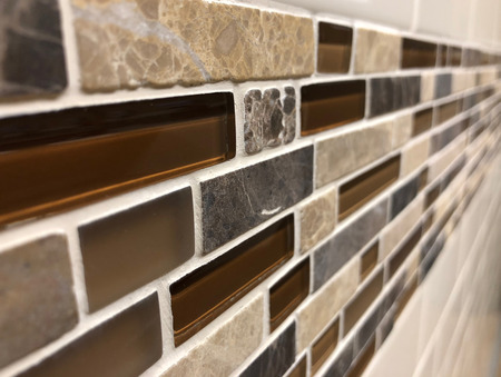 Beautiful glass and ceramic wall tiles installed in  bathroom or kitchen as a decorative backsplash