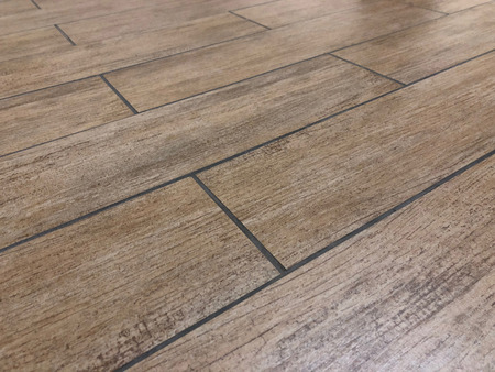 Modern ceramic or slate tiles installed in bathroom or kitchen as a floor. Renovation concept