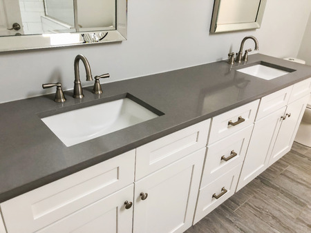 modern white bathroom wood cabinets with silestone countertop two sinks and chrome faucets