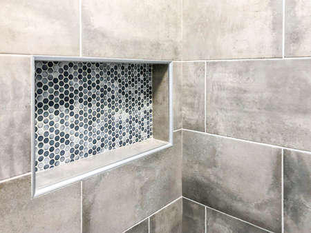 Beautiful modern tiles installed in bathroom shower. Renovation concept Stock Photo