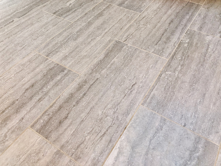 Slate tiles installed in bathroom or kitchen as a floor. Renovation concept Stock Photo