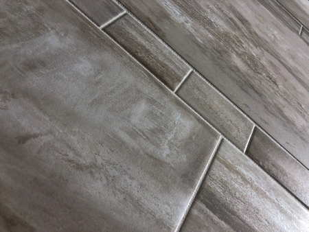 Beautiful ceramic or slate tiles in various sizes installed in bathroom or kitchen as a floor. Renovation concept Stock Photo