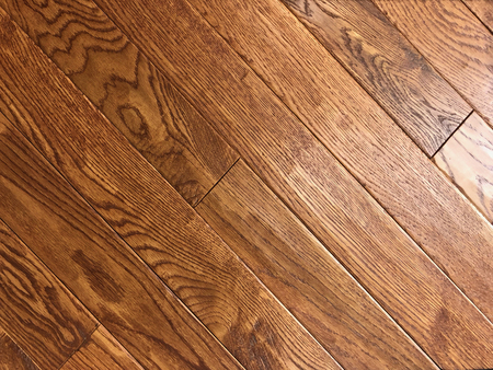 Brown red new installed hardwood floor made of maple wood Stock Photo