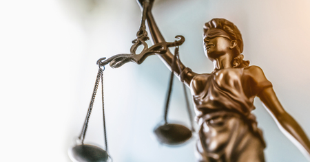 Statue of lady justice on bright background - Side view with copy space. Stock Photo