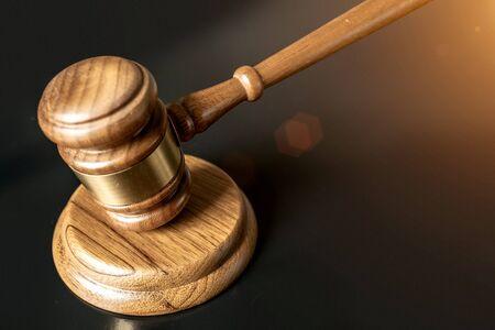 judge or auction Gavel on a wood block in courtroom, dark background Banco de Imagens - 128004056