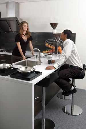 Young man and woman in the kitchen. photo