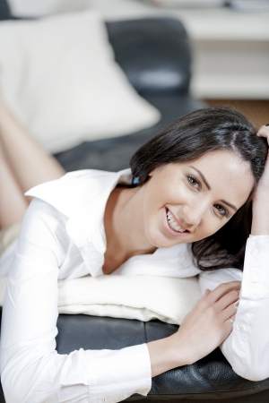 Young woman lying on sofa at home Stock Photo - 14015659