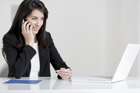 Young woman working at her desk in the office Stock Photo - 14015626
