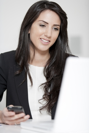 Young woman working at her desk in the office photo