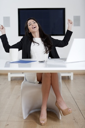 Young woman working at her desk in the office
