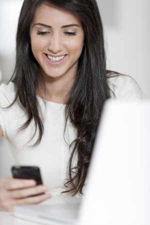 Young woman working at her desk in the office Stock Photo - 14015645
