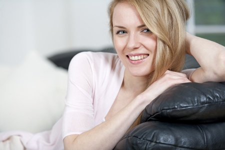 Young woman lying on sofa at home Stock Photo - 14015826