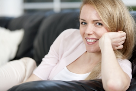 Young woman lying on sofa at home Stock Photo - 14015834
