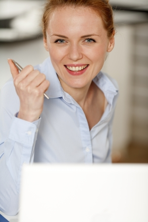 Young woman working at her desk in the office Stock Photo - 14015784