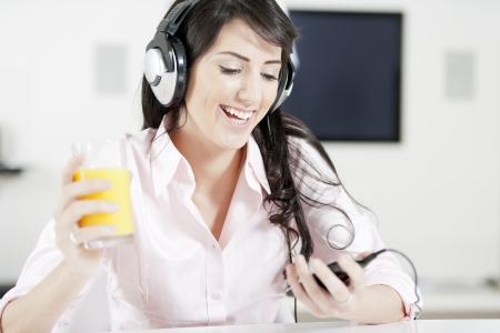 Young woman listening to music with headphones at home. photo