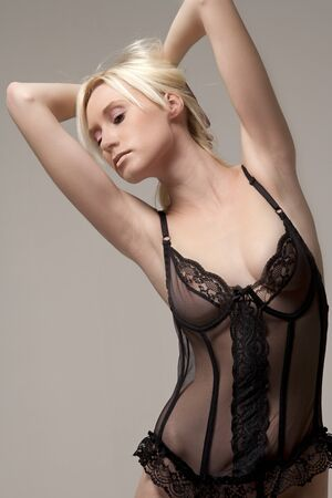 Female fashion model in black underwear Stock Photo