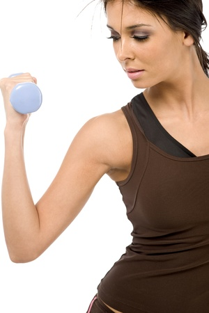 Young female undergoing fitness training on white background. Stock Photo