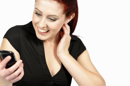 Professional young woman receiving good news on her mobile at work photo