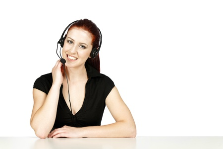Professional woman talking on a headset in her office at work. With white background Stock Photo - 14424616