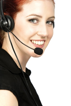Professional woman talking on a headset in her office at work. With white background photo