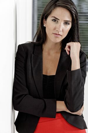 Professional working woman in corporate business clothes with a serious look photo