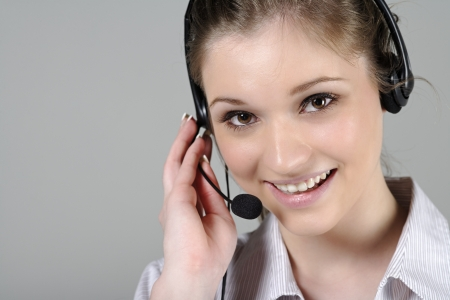 Young woman wearing a telephone headset talking on the phone Stock Photo