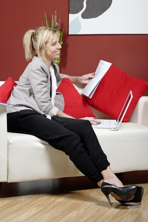 Proffesional young woman working from home photo