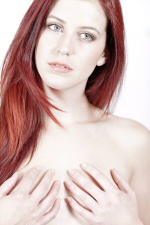 Sexy young woman covering her bare chest with her hands in a beauty style pose Stock Photo - 15441251