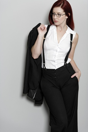 Beautiful young woman in smart business clothes in fashion style pose photo